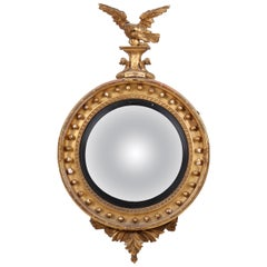 18th Century French Golden Regency Convex Mirror Topped by an Eagle