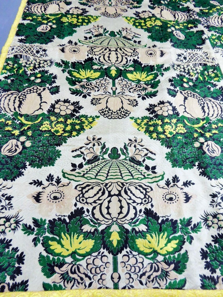 Circa 1730  France Lyon  A pannel (table cloth ?) of lampas silk in the Bizarre style dating back to the Louis XV period. Two strips sewn (58 cm width) with a roussette linen lining and weaven yellow straw braid. Lampas for the dress or the