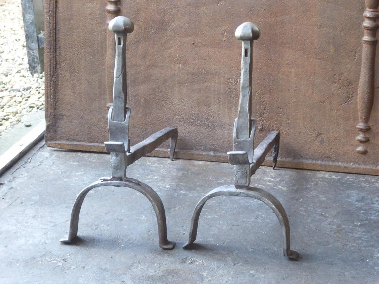 18th century French Louis XV andirons made of wrought iron. The andirons have spit hooks to grill food. The andirons are beautifully carved.