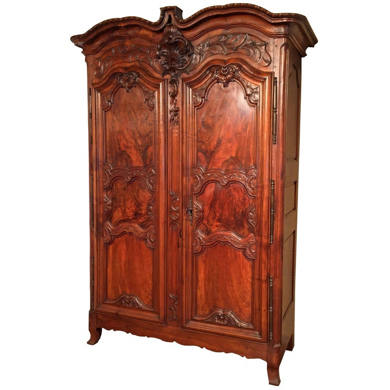 18th Century French Louis XV Carved Walnut Armoire from Lyon For Sale