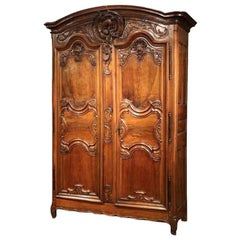 18th Century French Louis XV Carved Walnut Two-Door Armoire from Lyon