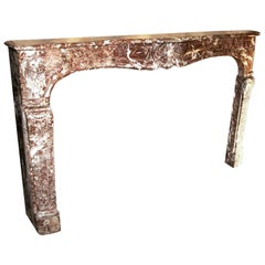 18th Century French Louis XV Marble Mantel Rouge Royale with Flower Details