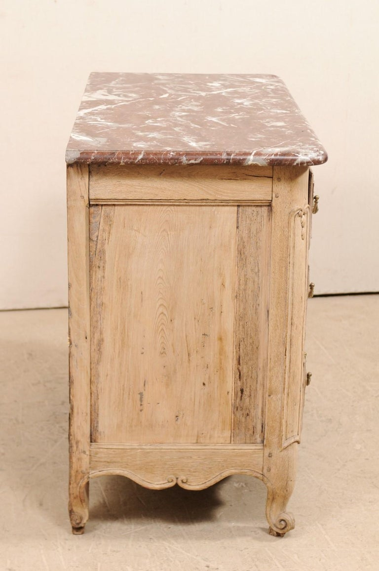 Carved An 18th Century French Louis XV Provincial Four-Drawer Marble Top Wood Chest For Sale