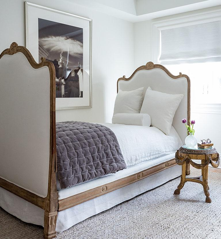 Beautiful 18th century French oak carved bed with headboard, footboard and two rails. Head, foot and one rail is upholstered. Lovely Louis XV bed that would function beautifully in a children's bedroom or guest room. Wonderful carved detail of