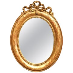 18th Century French Louis XVI Carved Giltwood Oval Wall Mirror