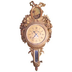 18th Century French Louis XVI Carved Giltwood Wall Clock with Oval Painting