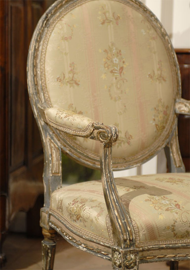 18th Century and Earlier French Louis XVI Period Late 18th Century Painted and Carved Wooden Fauteuil For Sale