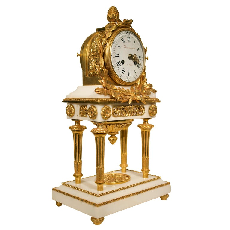 A charming 18th century French Louis XVI period Carrara marble and ormolu garniture set signed by Parisian clockmaker 'Jean- Simon Bourdier', whose clocks were housed in the finest and most elaborate cases suitable to furnish a number of royal