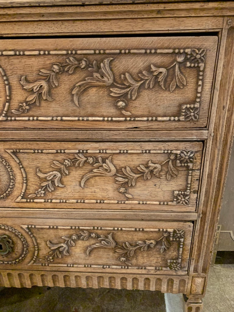 Exceptional 18th century French Louis XVI style carved and bleached chest.  Beautiful carvings including floral images. Lovely bleached patina on this piece as well. Gorgeous!