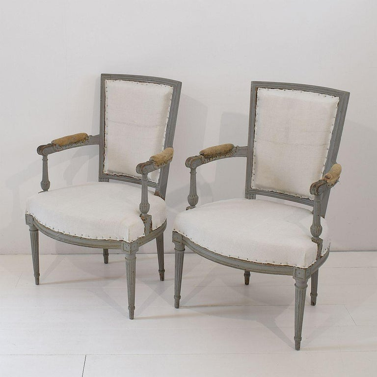 Beautiful pair of French original Directoire chairs, France, 18th century. At this moment in their underwear. Measures: Seat height is 42 cm. Weathered, small losses and old repairs. Despite of their high age, the chairs are relative stabile but
