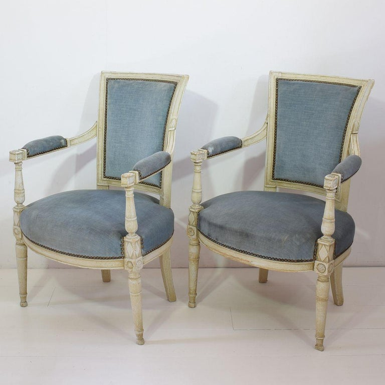 Beautiful pair of French original Directoire chairs, France, 18th century. Measures: Seat height is 46 cm. Weathered, small losses and old repairs. Despite of their high age, the chairs are in a relative good condition but could need some