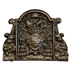 18th Century French Polished Iron Fireback with Family Crest and Tassel Decor