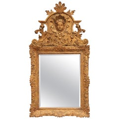 18th Century French Regence Carved Giltwood Wall Mirror with Ornate Pediment