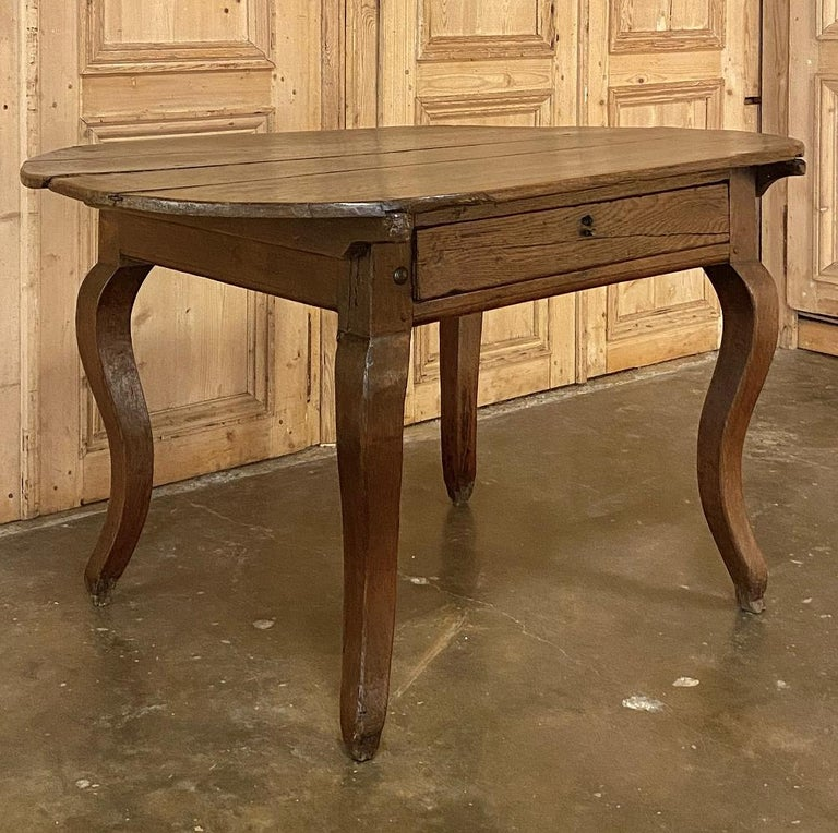 18th century French rustic writing table was crafted from a country home, probably owned by a noble or dignitary, who brought some of the concepts of convenient and