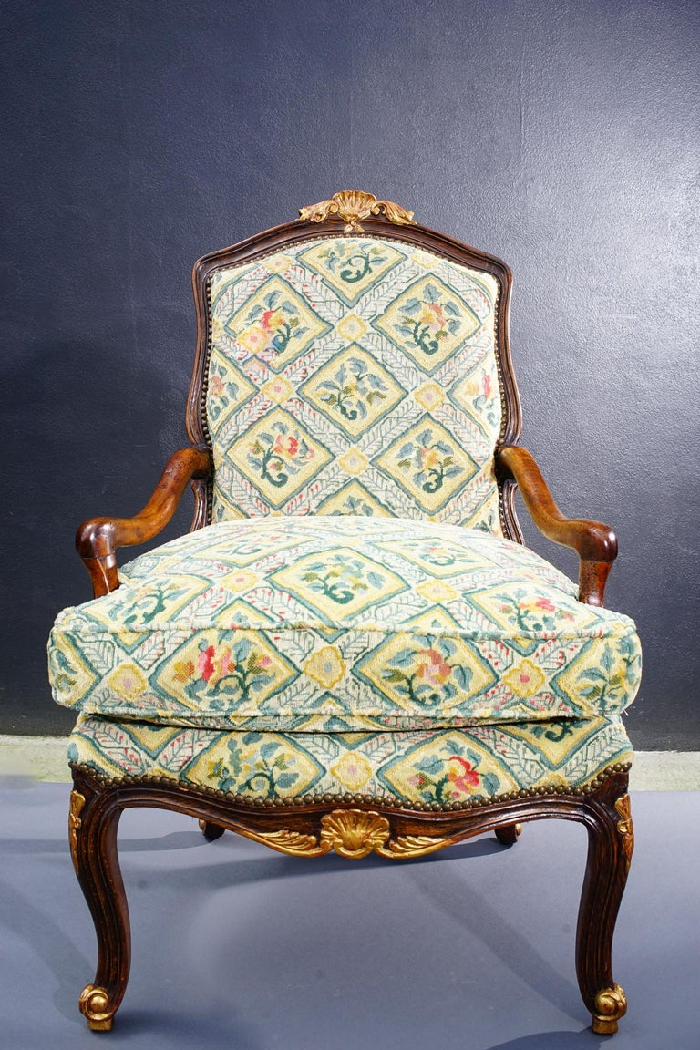 Hand-Carved 18th Century French Walnut Regence Armchair For Sale