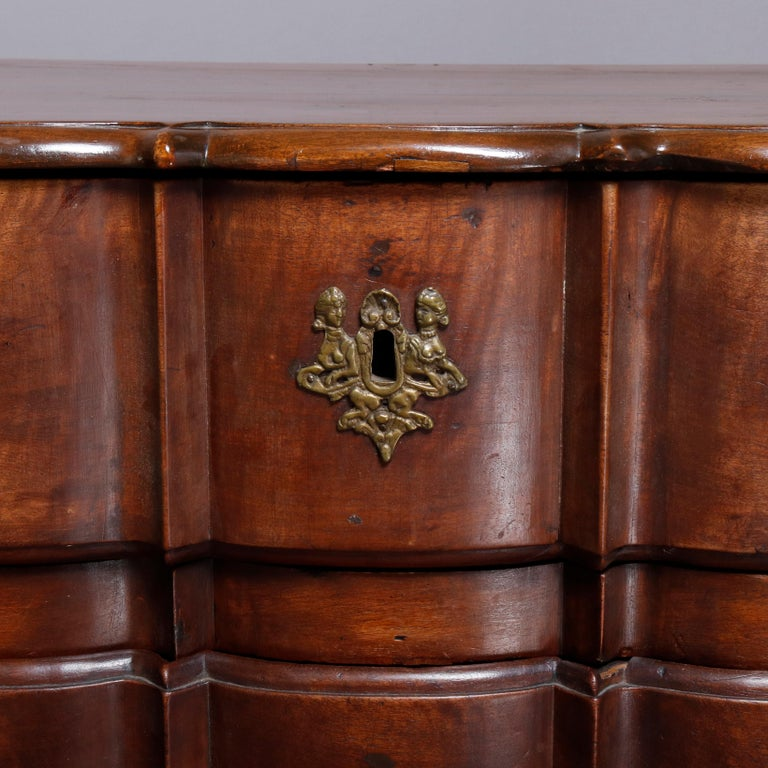 Cast 18th Century French Walnut Serpentine Commode with Figural Cherub Bronze Pulls For Sale