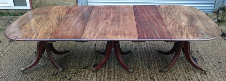 Antique dining table standing on three pedestals each with four splay base. This sort of base is very sought after, the shape is a Gillow design with the early high knee placement and very vertical waterfall shape to the legs. The close reeding on
