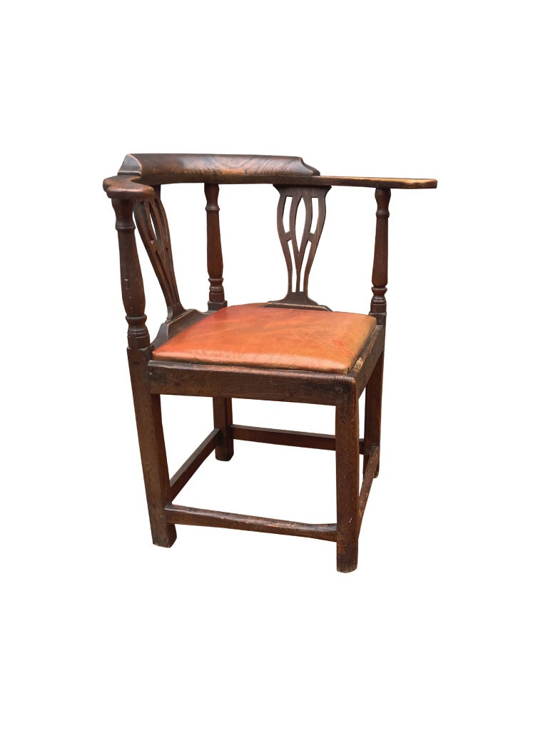 Antique George II corner chair hand carved from yew wood with leather upholstery, 18th century. We love the chair's beautiful, naturally aged wood, which has accrued a softened texture and warm tone over the centuries. The leather too has a fine,