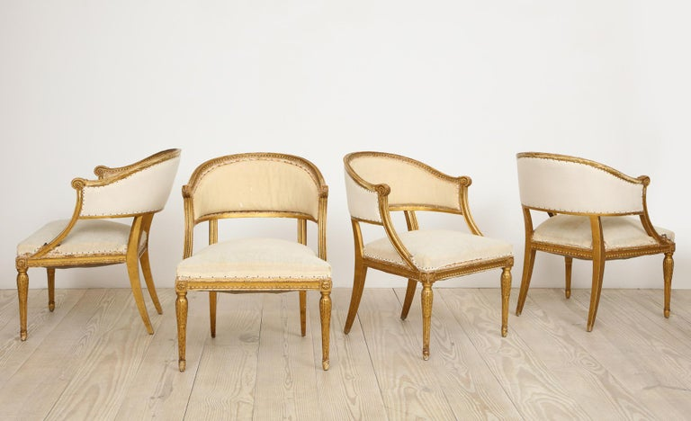 18th century Gustavian bucket chairs, set of four (4), giltwood, origin: Sweden, circa 1790.   Elegant proportions, beautifully hand-carved, extremely comfortable, neoclassical set of four barrel back chairs with very special patina.