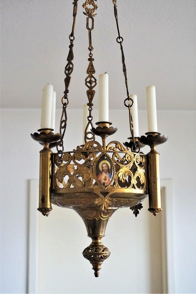 Stunning Gothic Revival style fire-gilded bronze and parcel-brass church candle chandelier / hanging sanctuary lamp, Spain, late 18th century, probably from a family with a private chapel. Crown shape body decorated with three hand-painted porcelain