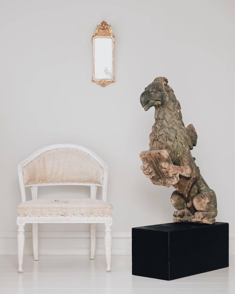 Impressive and unusually large mid-18th century Griffin in solid wood and incredible details with forepaws holding a shield, Sweden, circa 1750.  The date 1507 is inscribed on the lower left side, this is most likely wrong, the real date of this