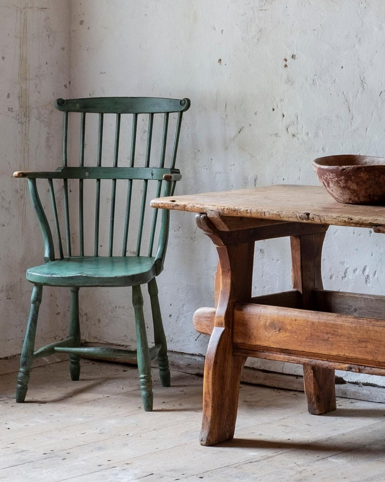 A rare 18th century vernacular Windsor style comb back armchair from the Gustavian period in secondary historical color, circa 1790, Sweden.  Good condition with wear and tear consistent with age and use. Structurally good and sturdy. A detailed