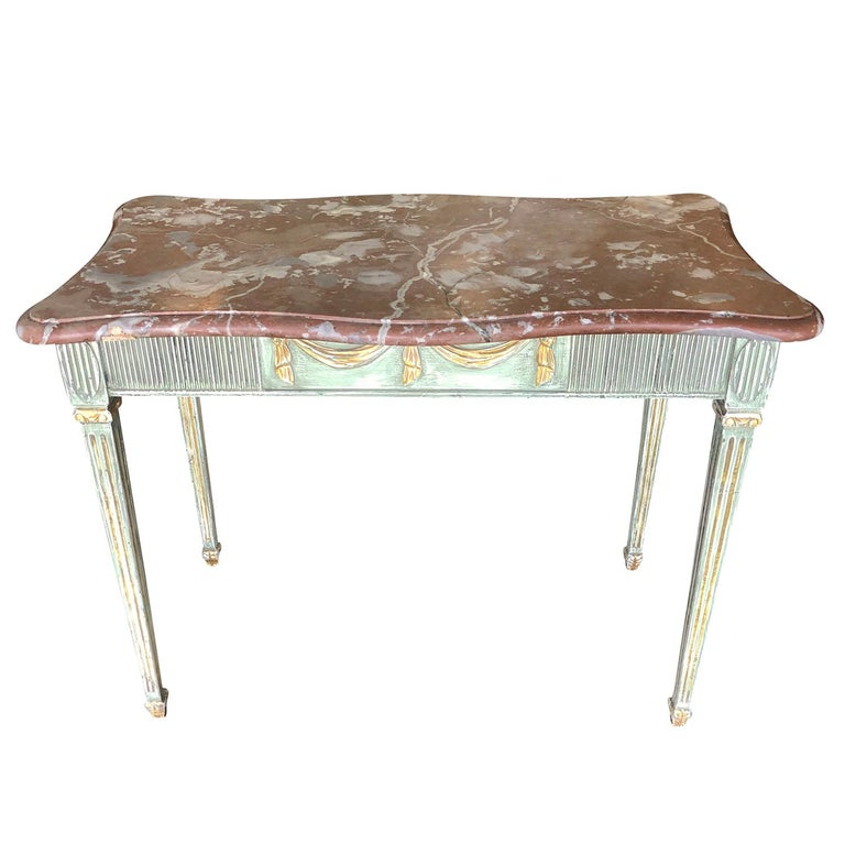 Late 18th century, a richly carved Gustavian freestanding console table with a red marble top and an original green paint, gilded wood finish. Wear consistent with age and use, circa 1790, Sweden. Scandinavia.