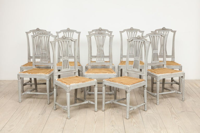 Swedish, 18th century neo-classical Gustavian dining chairs with drop-in seats, set of 10, Origin: Swedish, circa 1790.  The Gustavian, neoclassical period is characterized by a return to symmetry and straight lines, antique motifs such as laurels,