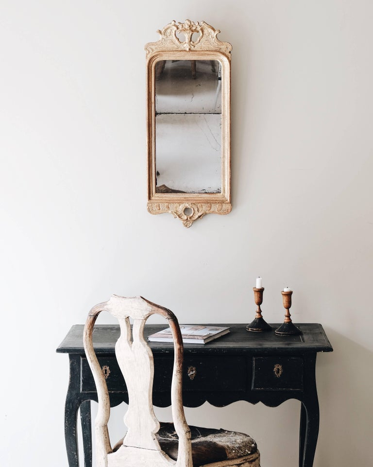 Fine 18th century transitional Rococo / Gustavian giltwood mirror in its original finish and mirror glass.   Signed IS (Joseph Schürer active 1769-1785) and stamped with the Stockholm mirror makers guild 1775, Stockholm, Sweden.
