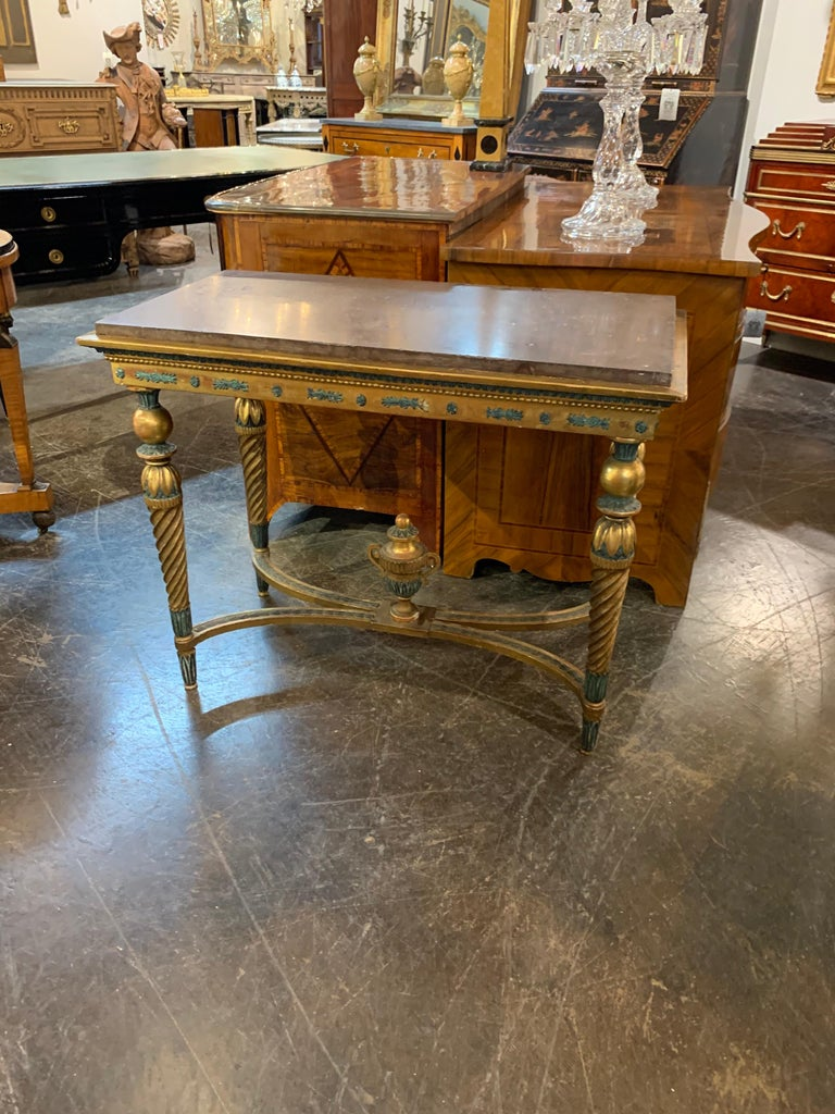 Late 18th century Swedish Gustavian style carved parcel-gilt console table with original rouge marble top. Very fine carvings including an urn on the bottom of the piece. The gilt is also very nice and there are dark green painted details as well.