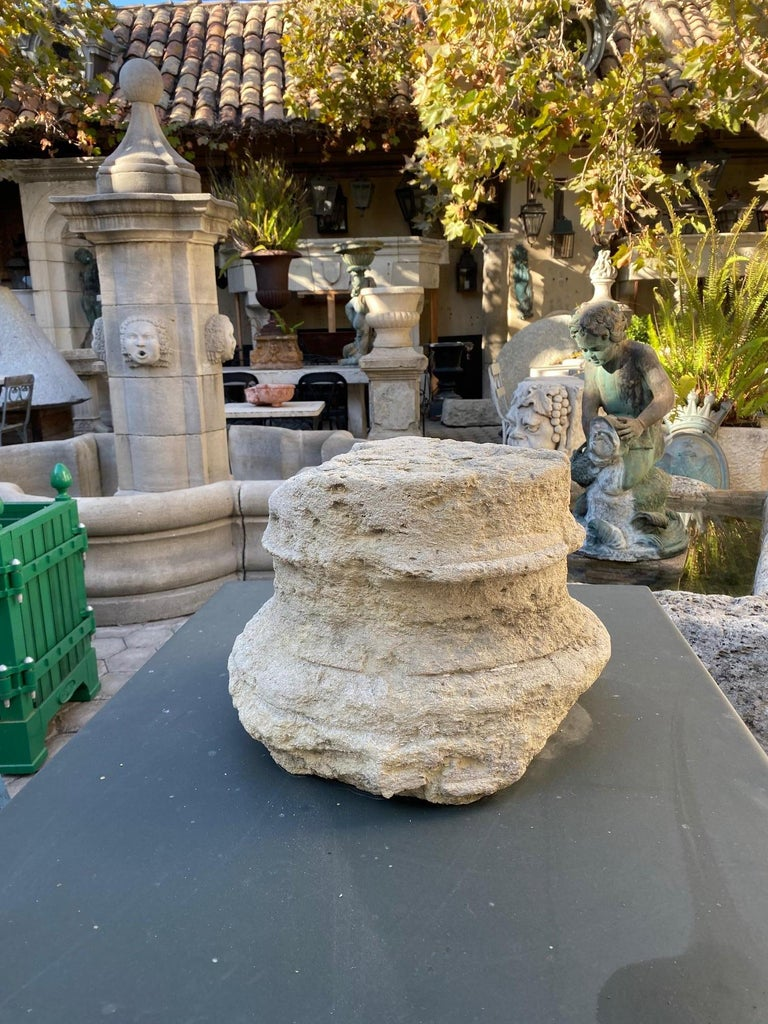 Nicely hand carved 18th century stone column base, it could be used as a capital architectural element in an entryway or as a doorstop, a statement sculpture of carved limestone Chapiteau from a cloister in France. From an ornamental point of view,
