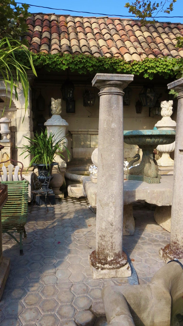 Nicely hand carved total of five available 18th century stone columns sitting on base square pedestal. Could be sold as a single column to be placed in a garden as an architectural decorative element, focal point or to top it with a finial or mount
