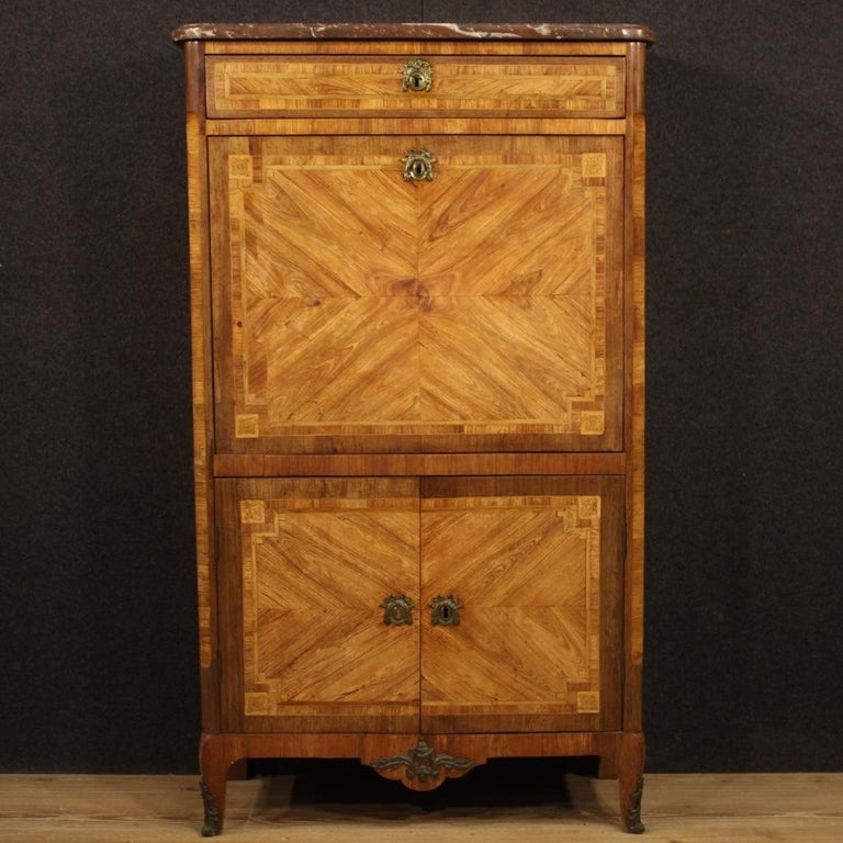 Antique French secrétaire from the Louis XVI era. High quality furniture with gilded bronze decorations and inlaid in walnut, rosewood, oak, mahogany, maple, tulipwood and fruitwood. Secrétaire equipped with original marble top which has undergone a