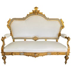 18th Century Italian Blue and Gilt Settee with Putti an Ornate Carved Details