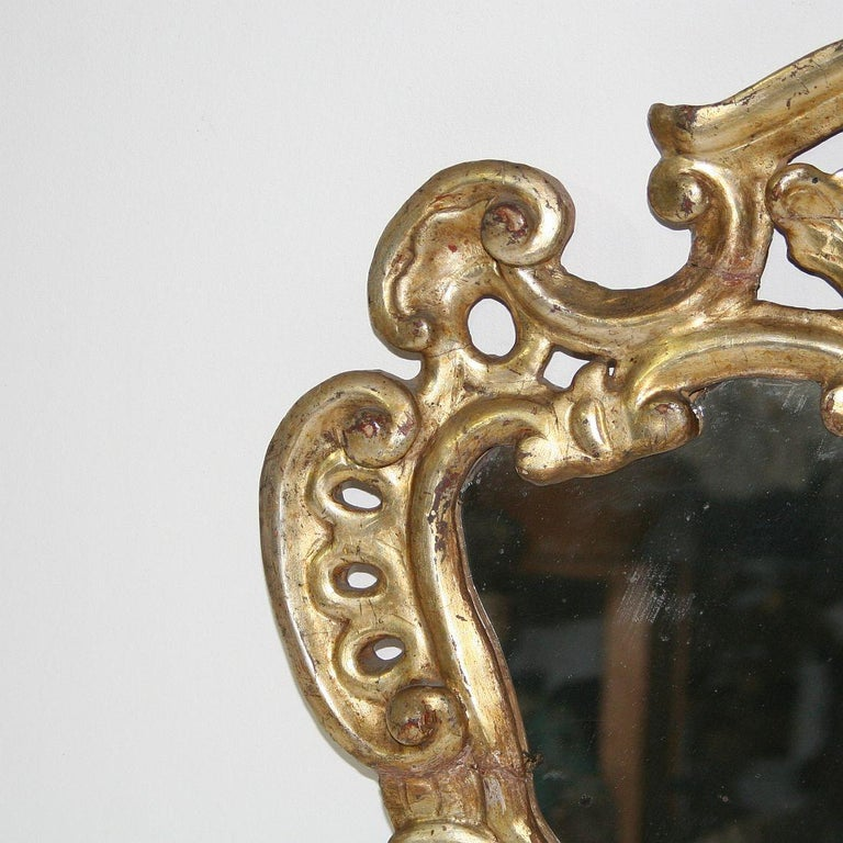 Hand-Carved 18th Century, Italian Carved Giltwood Baroque Mirror For Sale