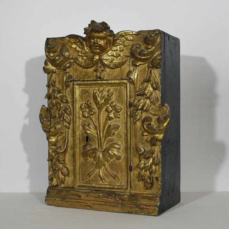 Unique tabernacle with its original gilding. Great piece to display a small private collection. Great color and beautiful angel face, Italy, circa 1700-1750. Weathered, small losses and old repairs.