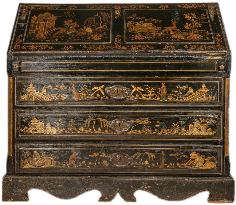 An impressive 18th century Italian black lacquer, chinoiserie bureau bookcase, having wonderful gilded oriental scenes to the doors, fall and drawer fronts, shelves, pigeon hole and compartments to the bookcase and bureau interior, painted in a