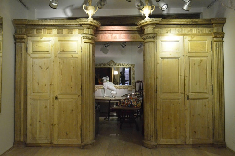 It is form Italy from late 18th century. This huge wood armoire measures 480 cm W, 75 cm D, 290 cm H. It features four pine wood doors, it is an archive equipped with internal original shelves, original hardware and original backs. The rest of the
