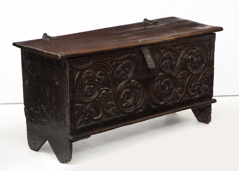 Handsome deeply carved coffer / trunk depicting a Jacobean theme of vines and floral elements. Aged wax finish gives this piece a terrific patina.