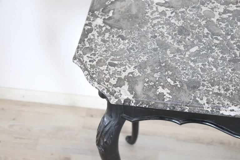 Important antique centre table Louis XV, 18th century. The coffee table has elegant shaky legs with very refined carved wood. The top is in grey marble whose shape follows the table line. Fascinating internal discovery is an ancient paper where we