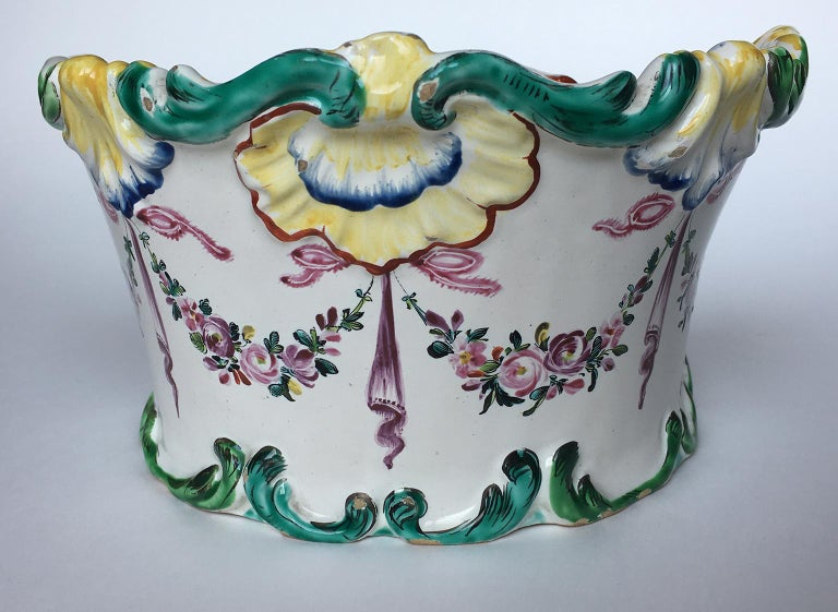 """Maiolica flower pot """"a mezzaluna""""  decorated with garlands of flowers  Pasquale Rubati Factory Milan, circa 1770 Measures: 4.7 in x 5 in x 8.8 in 12 cm x 12.8 cm x 22.4 cm lb 1.76 (kg 0.8) State of conservation: intact with slight chipping due to"""
