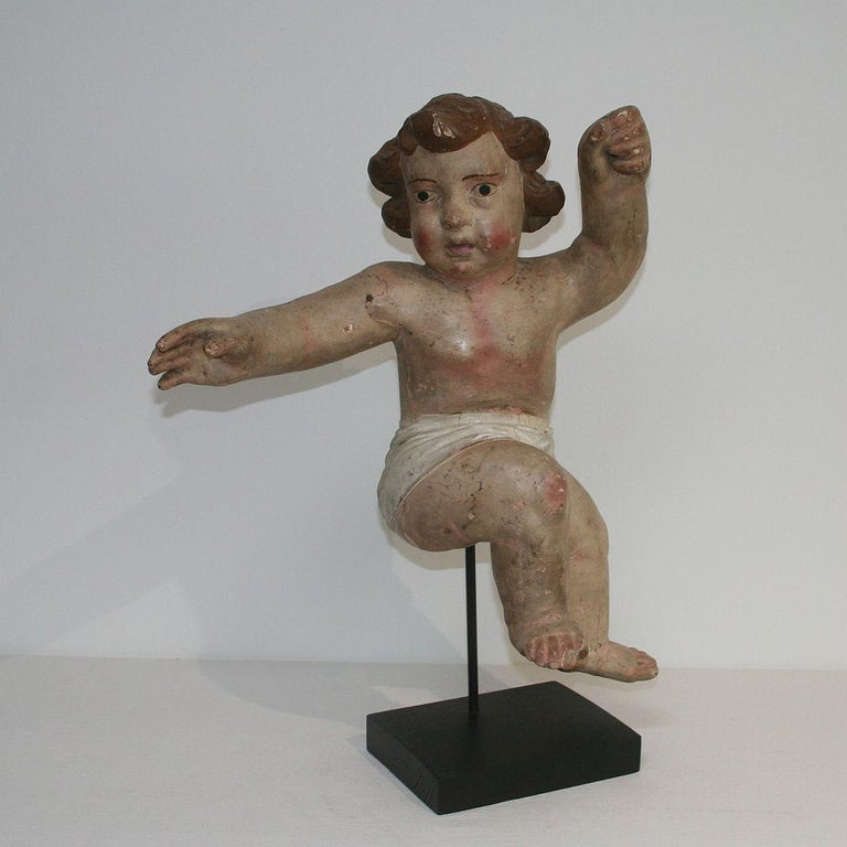 Beautiful Primitive Baroque angel, Italy, 18th century. Weathered, small losses. Measurement with the base.