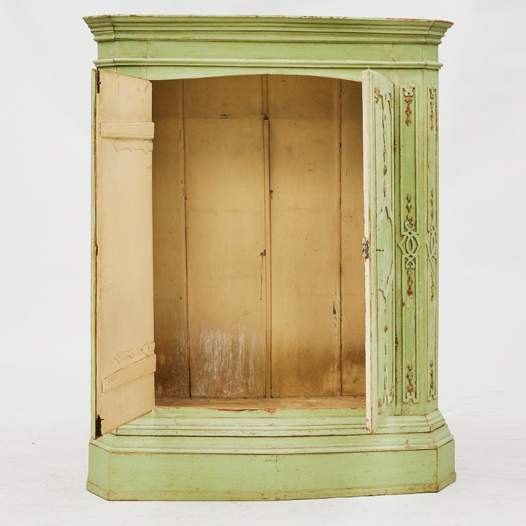Italian Rococo cabinet. Original green color. Pair of doors, elegant original details.