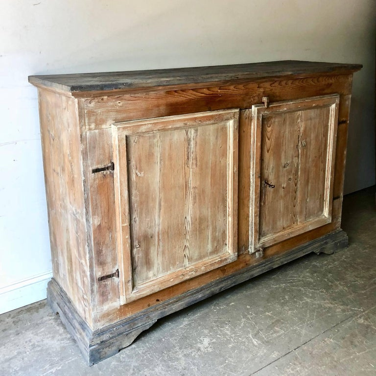 Handsome, large 18th century Italian sideboard with two large panelled doors and all original locksand hinges.