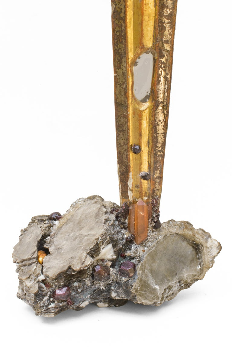 18th century Italian wood sunray with gold and silver leaf with inserts of antique mirror and stained glass on a coordinating mica base encrusted with garnets. Sunray is also decorated with tangerine crystal quartz points and a coordinating natural
