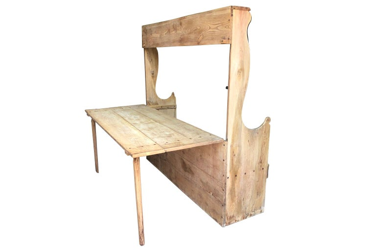 A very unusual 18th century table - bench from Northern Italy. Soundly constructed from hard pine, this very interesting piece converts from a bench - into a bench and table. The depth of the bench is 19 1/4