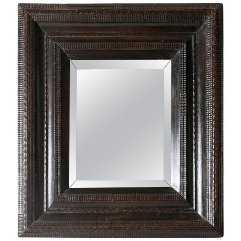 18th Century Italian Walnut Ebonized Mirror with Finely Carved Guilloche Detail