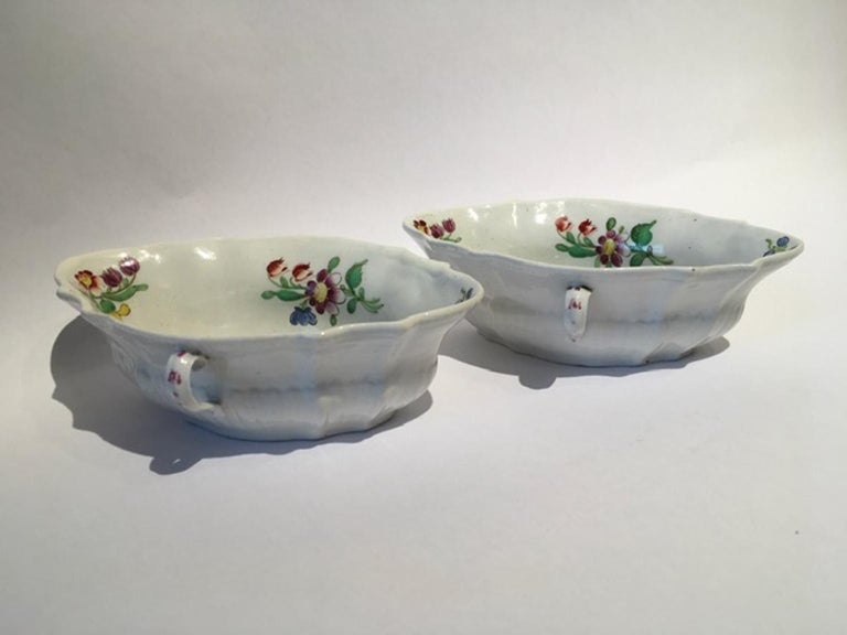 This is an elegant pair of porcelain sauce bowls with floral drawings in red and blue. It is beautiful for a table dressing or to collect. The production of this well known Italian factory is most wanted by the best international collectors.  In