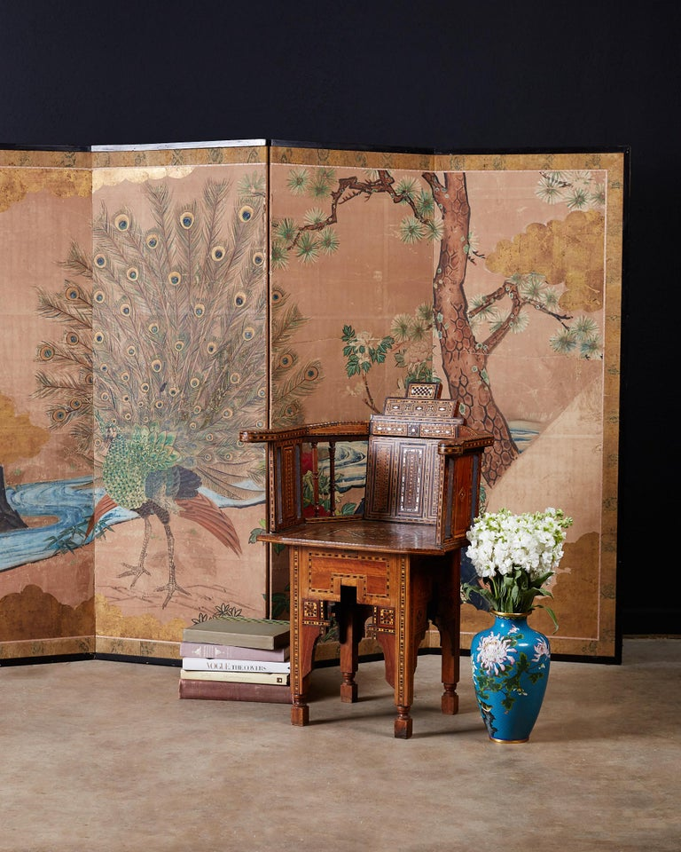 Fantastic 18th century Japanese four panel depicting a peacock landscape. Edo period screen made in the Kano school style of painting. Sumi Gofun and color on gold paper with beautiful gold leaf accents around the borders. The naturalistic painting