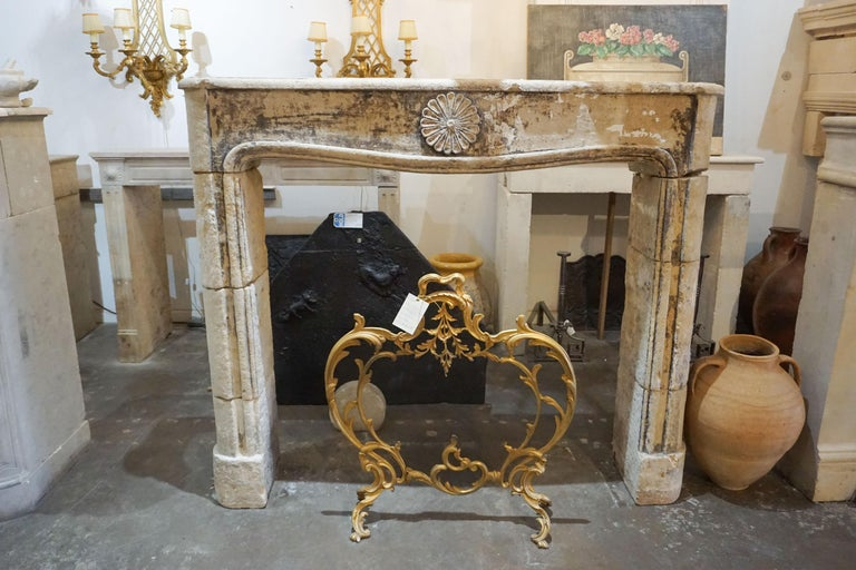 This 18th century mantel is made of limestone and originates from France, circa 1700. Beautiful aging as seen in the patina.
